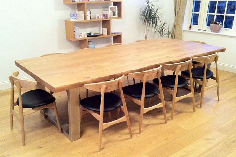 this large oak dining table can take any amount of weight or everyday use because of the immense strength of the thick oak top and base locked together