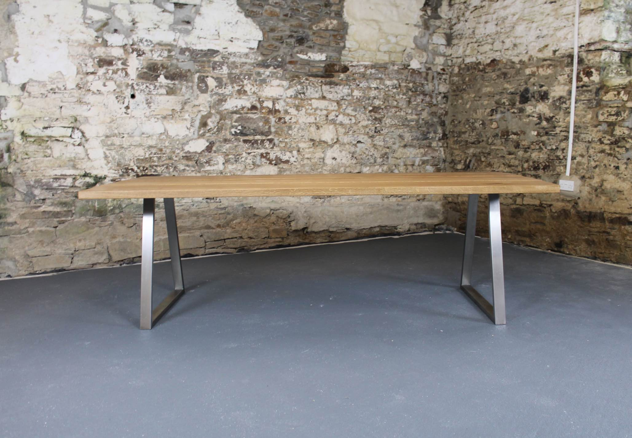 The table pictured is 2400 x 1100mm to comfortably seat 8 people
