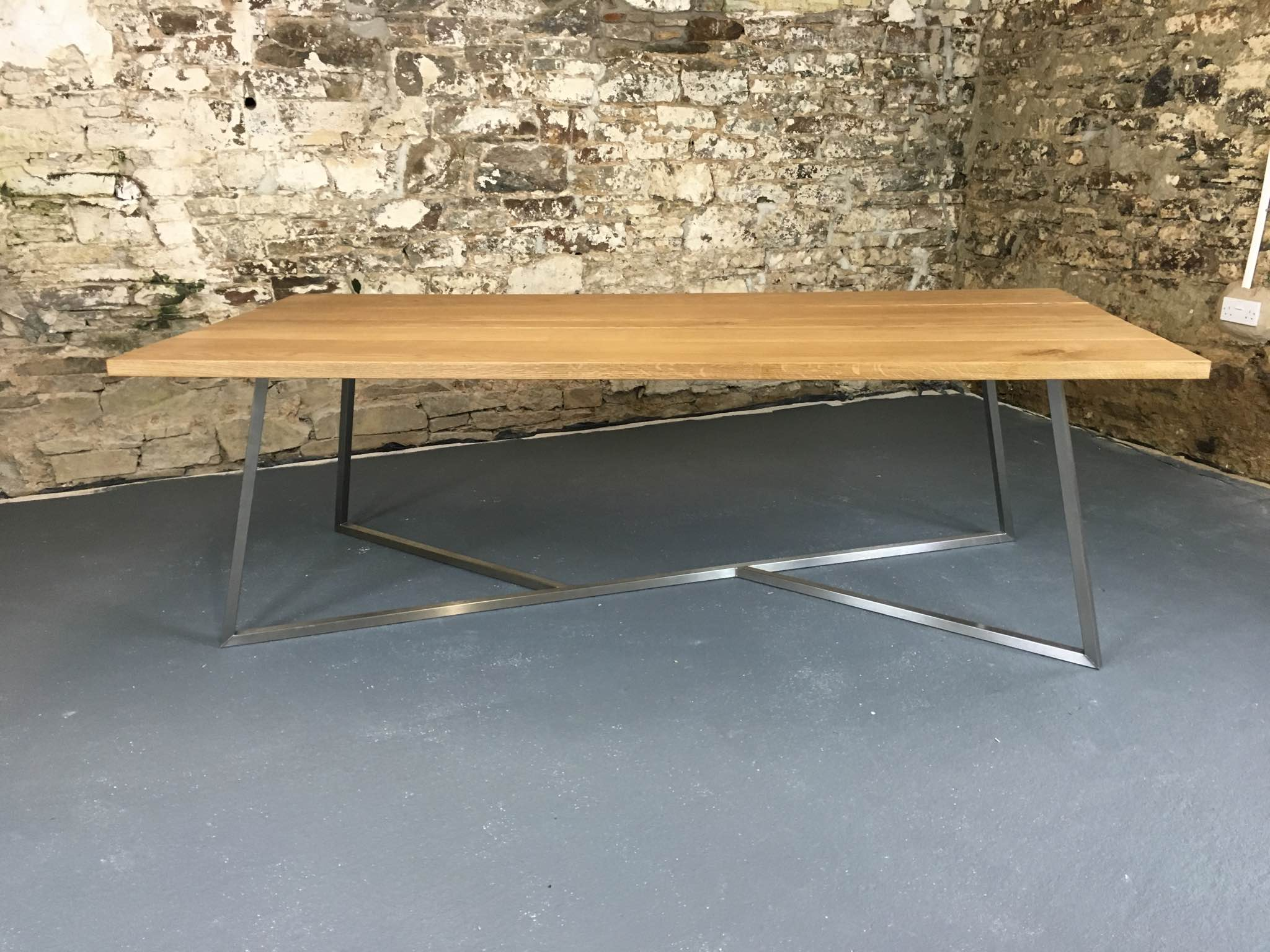 This table seats 8 people at 2400 x 1100mm