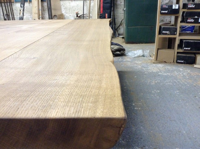 Painstakingly Hand-finished natural edges from the trunk of the oak tree