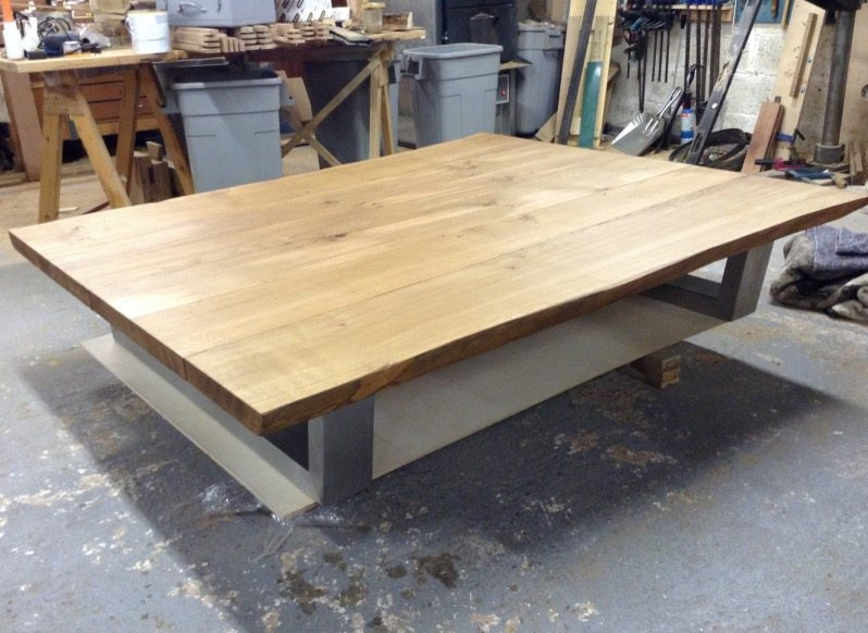 84d8a4b951f05 This natural edge coffee table can take any amount of weight or everyday  use because of the immense strength of the thick oak top and base